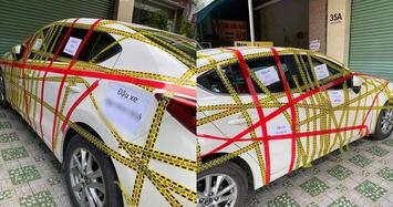 Xe Mazda3 bị dán băng dính như 'bó giò' vì chủ đỗ ẩu
