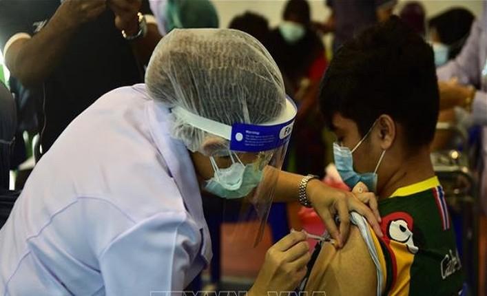 Cac nuoc dang tiem vaccine ngua Covid-19 cho tre em nhu the nao?-Hinh-11